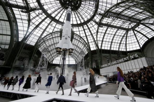 A rocket is launching as models present creations by German designer Karl Lagerfeld as part of his Fall/Winter 2017-2018 women's ready-to-wear collection for fashion house Chanel during Fashion Week in Paris